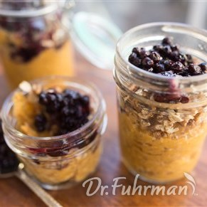 Cinnamon-Spiced Sweet Potato Breakfast topped with Pecan Granola and Blueberry Sauce
