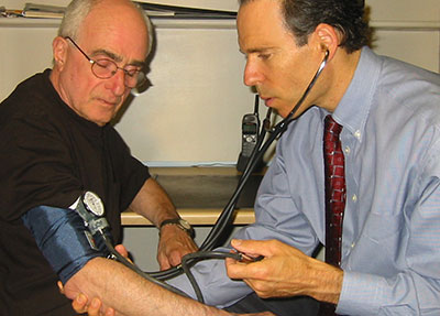 photo of Dr. Fuhrman monitoring blood pressure